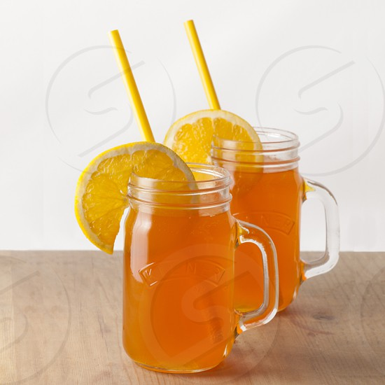 Orange beverage summer fruit two bottle photo