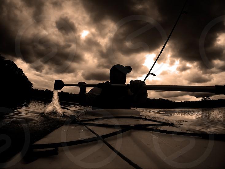 Kayaking at dusk photo