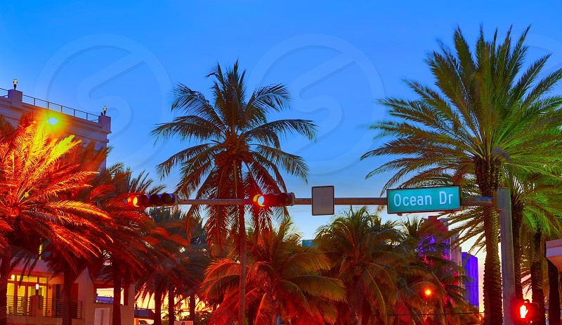 Miami Beach South Beach sunset in Ocean Drive sign Florida photo