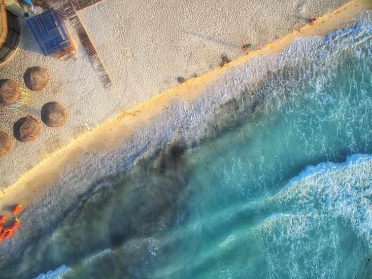 ocean wave near white sand during daytime photo