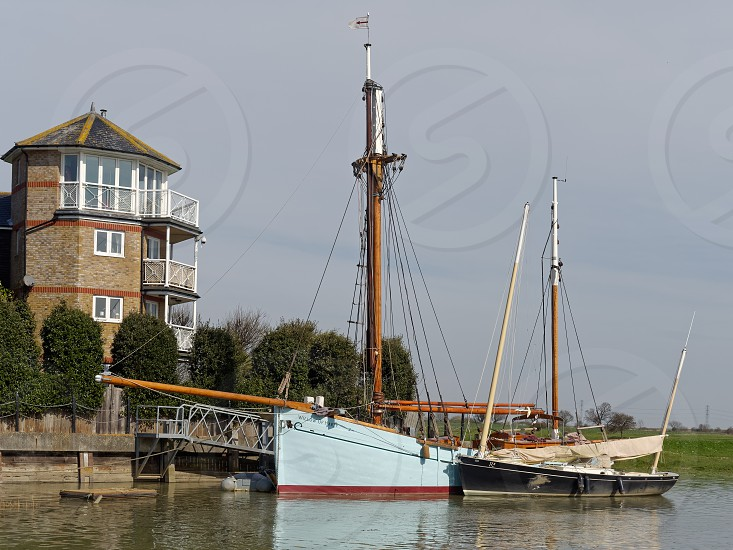 FAVERSHAM KENT/UK - MARCH 29 : Boats moored on the Swale in Faversham Kent on March 29 2014 photo