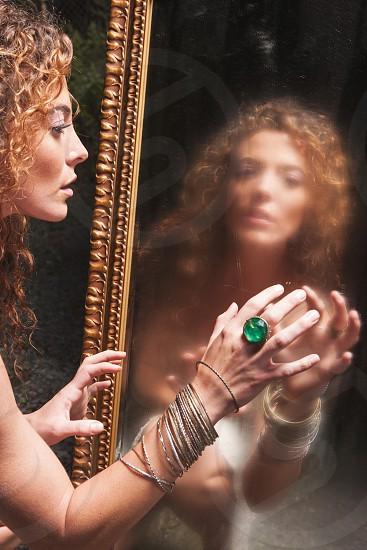 woman staring on mirror photo
