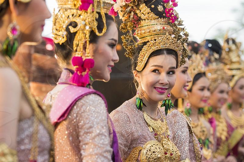 traditional dresst thai women at the Loy Krathong Festival in the Historical Park in Sukhothai in the Provinz Sukhothai in Thailand.   Thailand Sukhothai November 2018 photo