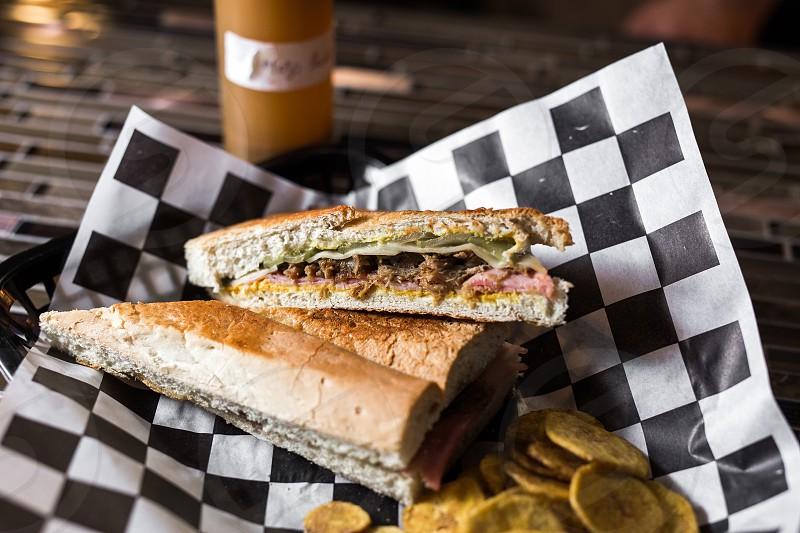 "A cuban ""sloppy joe"" sandwich and fried plantains. photo"