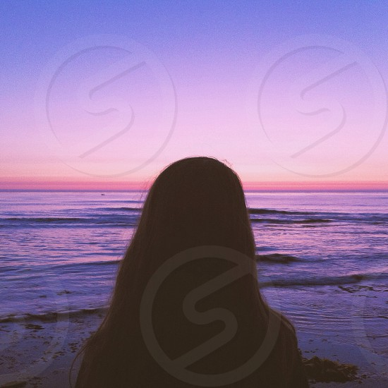 woman silhouette on ocean view photo