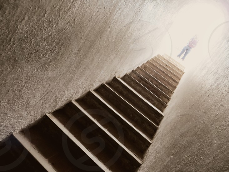 Light at the top of a stairway. Stairs. photo