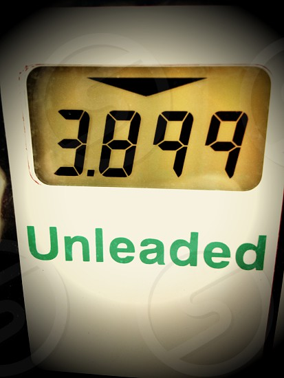 Fuel price for a gallon of unleaded gasoline on a gas pump. photo