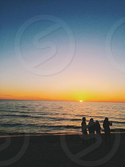 Lake Michigan sunset with friends photo