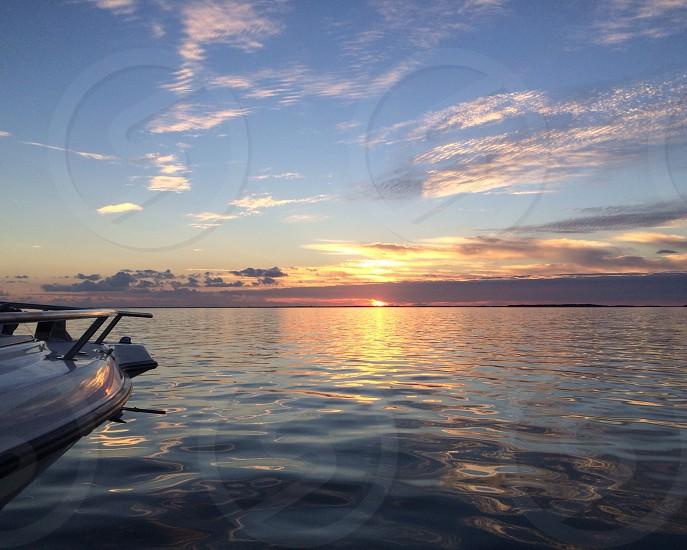 Sunset in key largo on a boat photo
