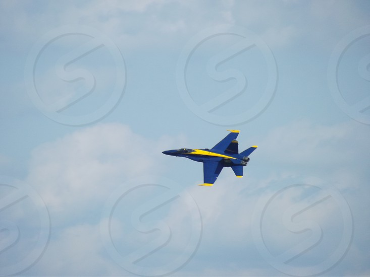blue and yellow jet plane photo