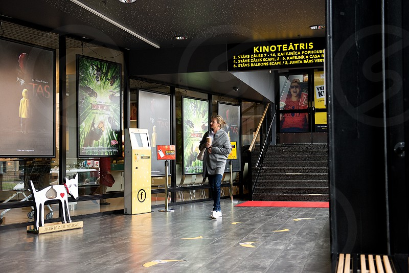People waiting for movie at cinema photo