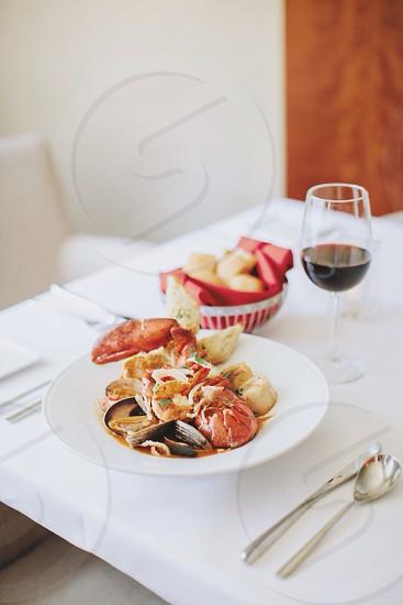 crawfish dish on white ceramic round plate photo
