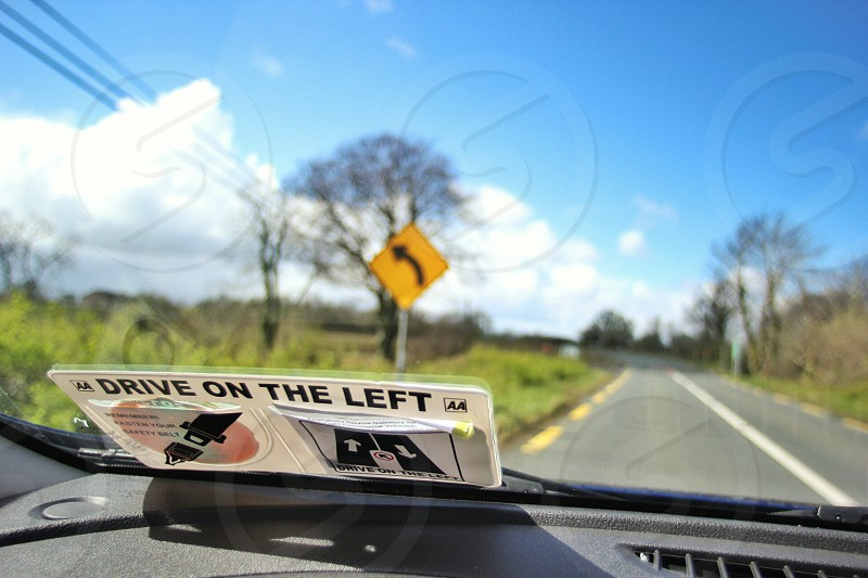 drive on the left sign on a car windshield photo