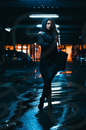 Night life | Nightlife in the city | Woman walking outdoor at night photo