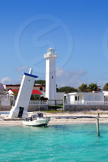 Lighthouse new and old inclined Puerto Morelos Mayan Riviera Mexico photo