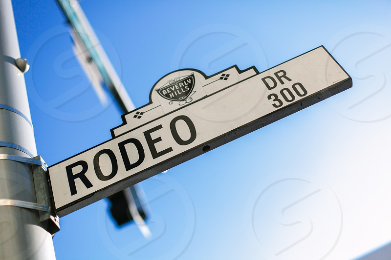 Rodeo Drive street sign on a beautiful blue sky California day photo