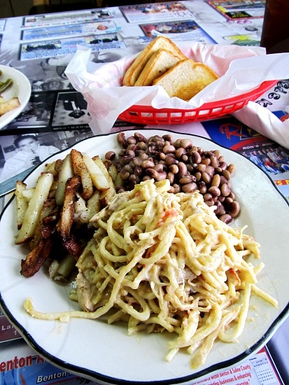 Chicken spaghetti with purple hill peas home fries and toast photo