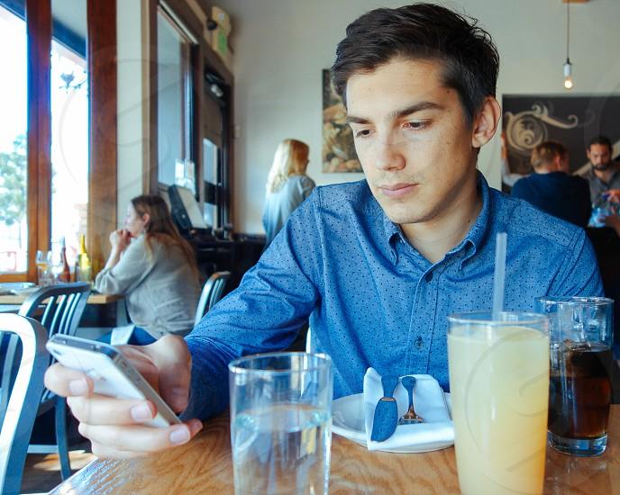 men's blue long sleeved shirt photo