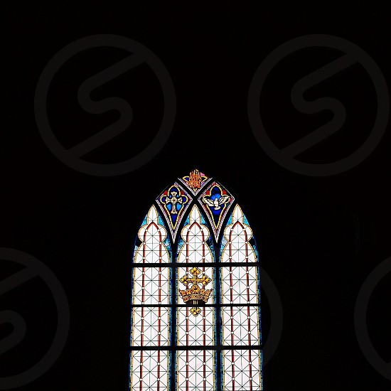 white and blue cross design stained glass  photo