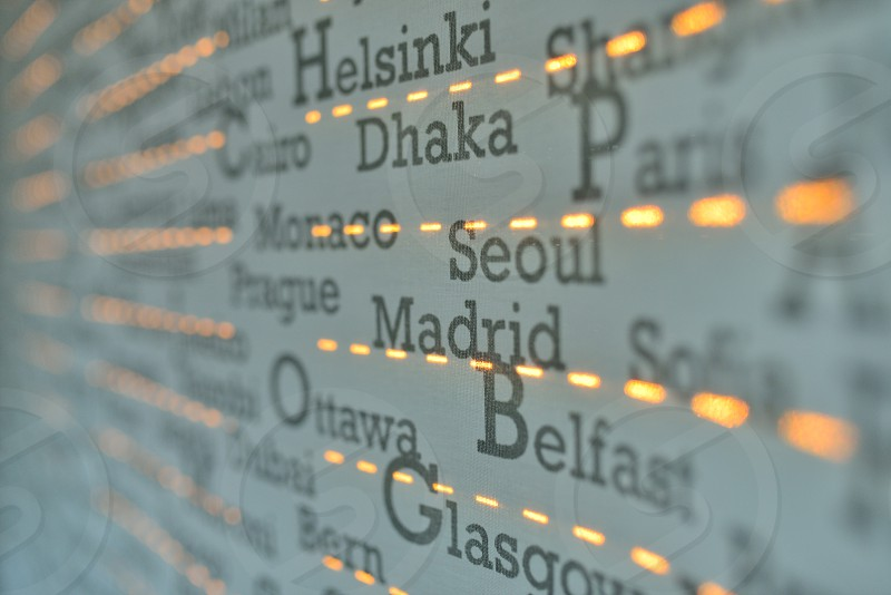 Background of world cities text at sunset photo