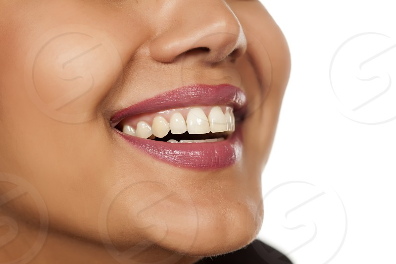 a smile of a woman with a beautiful white teeth photo