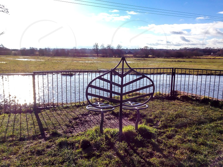 Riverside views bickerley Ringwood water ripples wrought iron benches nature photo