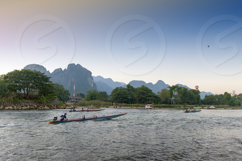 Boat service for tourists in Nam Song River Vang Vieng Lao PDR. photo