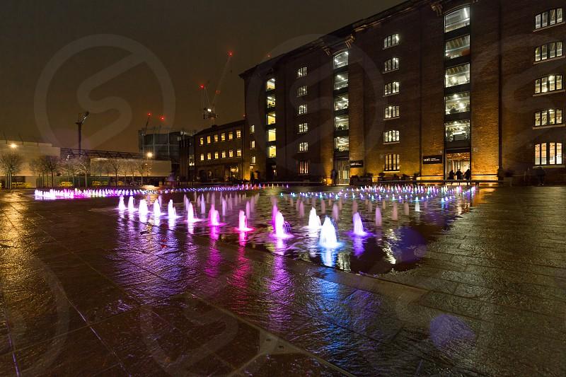 Granary Square at night with LED illuminated fountains photo