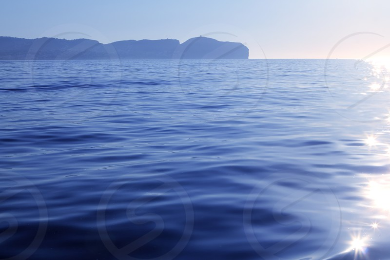 Nao Cape far view blue reflection water Alicante province Spain photo