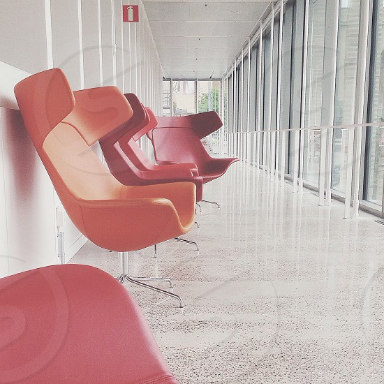 red and orange plastic egg chairs photo