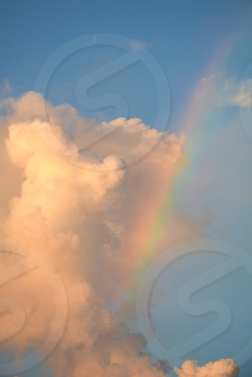 Early morning sunlight creates a rainbow in a cloudscape photo