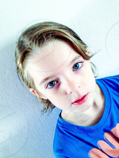 High Contrast Girl Female Blue Angle Creative Wall Portrait Short Hair Blue Eyes Focus Stare photo