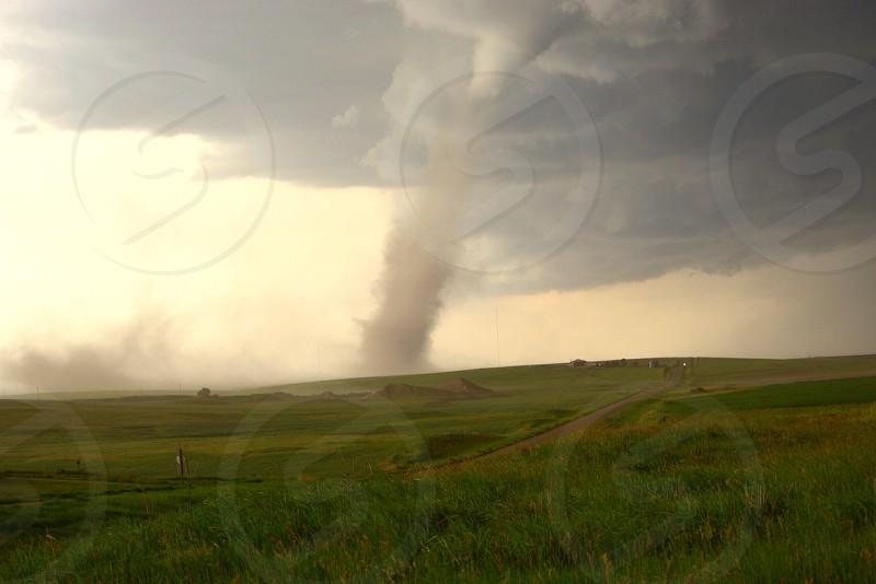 """A weak but very photogenic """"landspout"""" tornado skips across an open farm field near Brewster KS on 6/27/14. photo"""