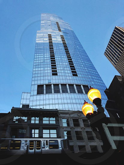 Architecture. Street lights skyscraper blend in blue low angle cityscapes modern and classic train photo