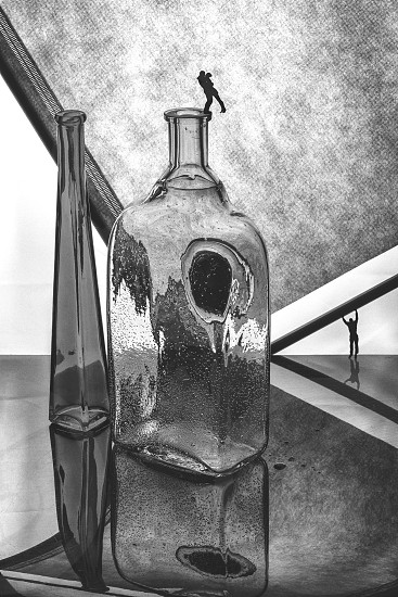 Black and white still life with glass bottles and silhouettes of people. Love story. photo
