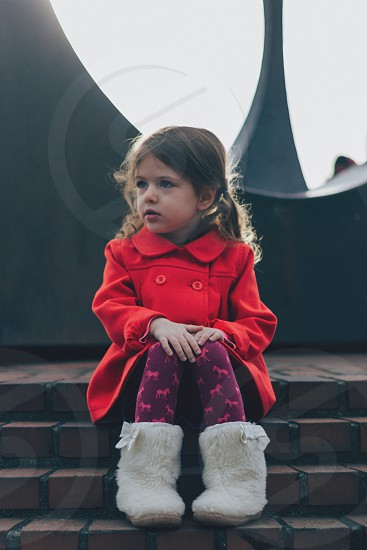 girl in red trench coat photo