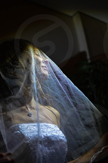 woman wearing white bridal gown  with white veil photo