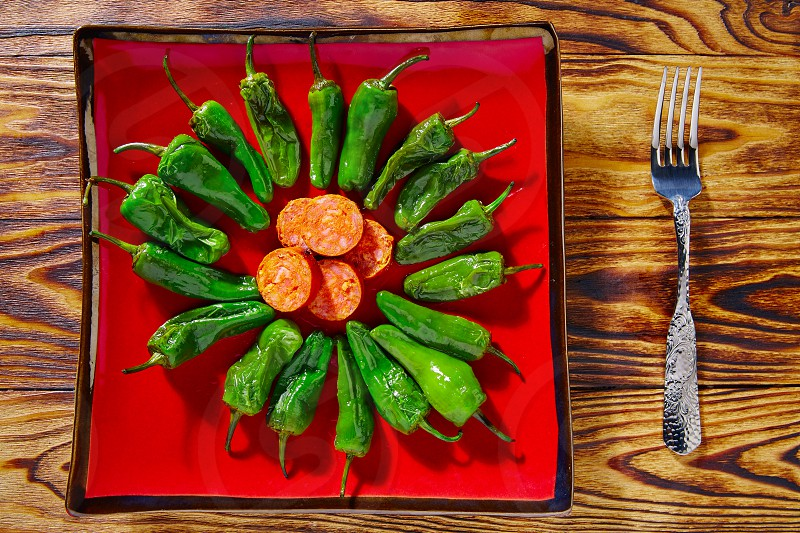 Tapas pimientos del Padron green peppers with sausage photo