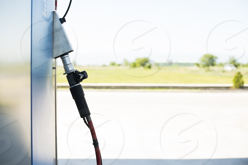 Device for charging gas car on gas station. photo