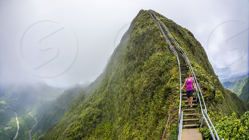 woman walking down the stair on mountain top during foggy daytime photo