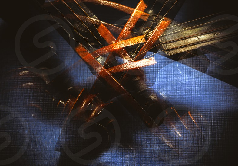 Abstract composition of an old violin blended and accentuated shapes and textures of an instrument.  photo
