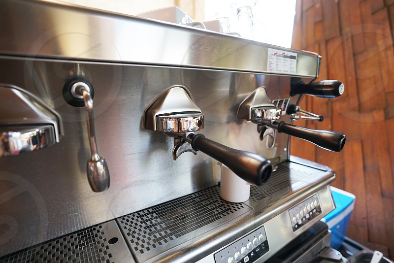 luxury espresso coffee machine and stream milk photo