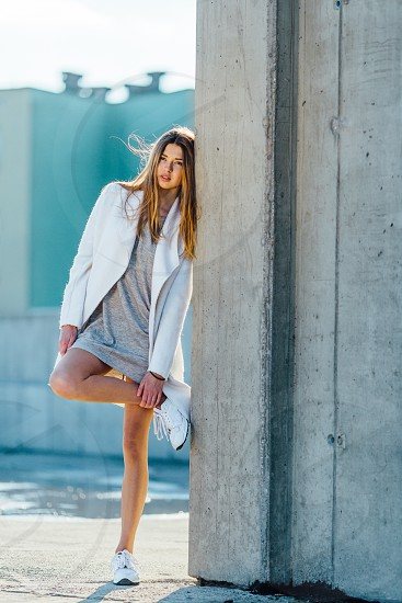 girl with white coat and grey dress photo