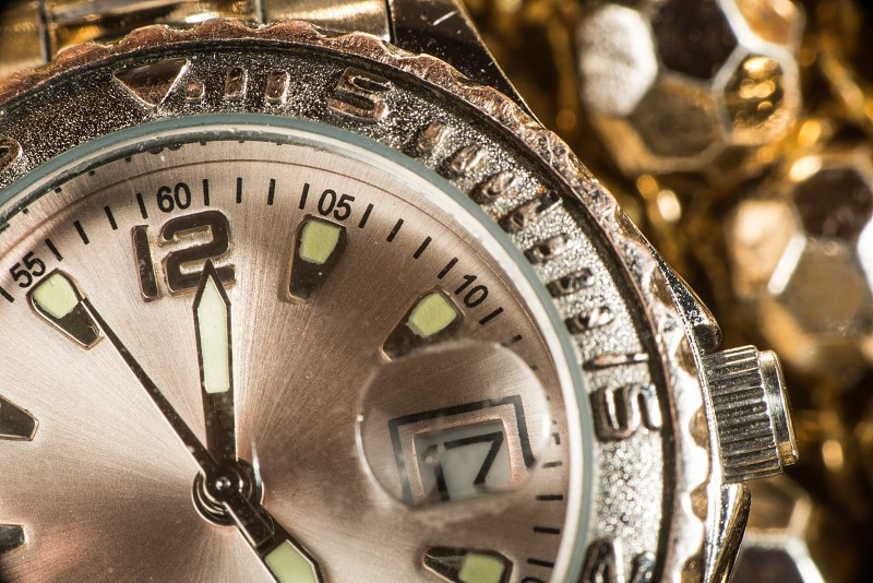 Shiny gold color watch. Studio macro shot photo