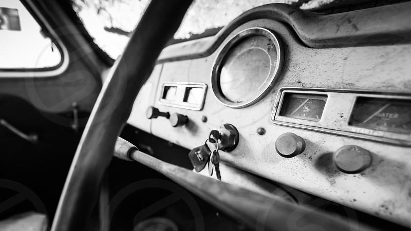 Austin automobile car vintage Austin A40 Somerset car keys old dirty car steering wheel black and white dashboard ignition window car photography Ian Jones Photography Austin Motor Company 1952 photo