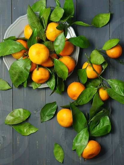 tangerines with leaves orange food bright grey photo