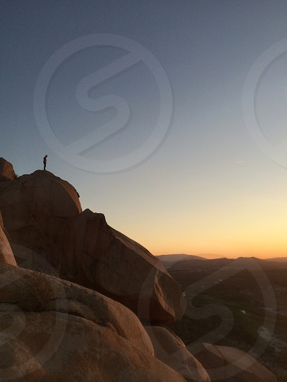 man in a brown mountain standing silhouette  photo