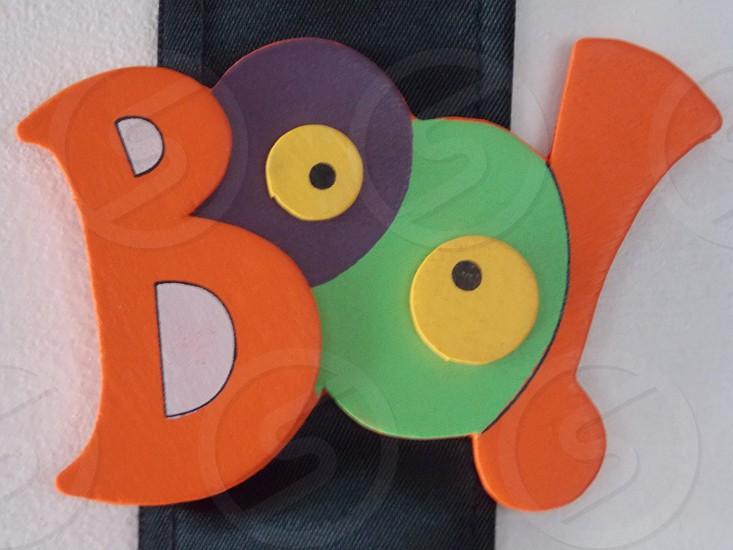 orange purple and green boo! signage photo