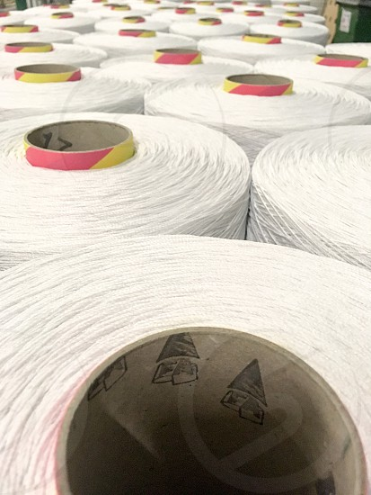 Yarn carpet production white rolls photo