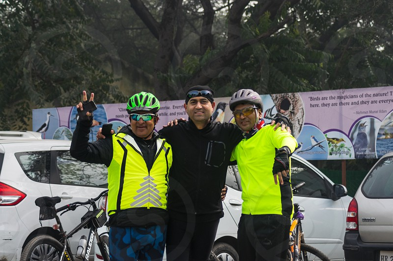 Cyclist showing victory sign photo